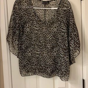 Tops - A sheer leopard print pull over blouse